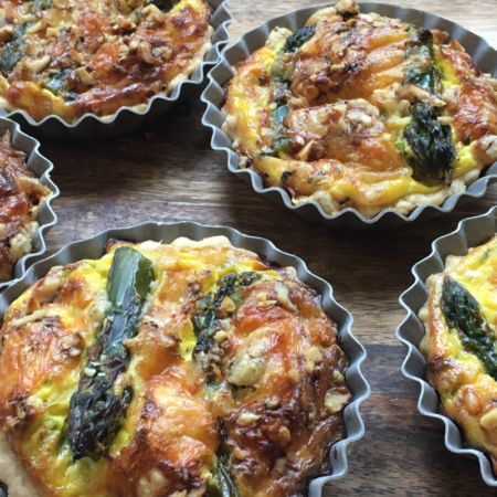 A close up of four Asparagus and Cornish Blue Tarts